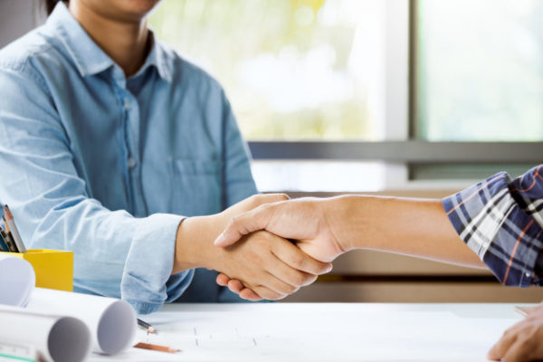 architect-engineer-shaking-hand-office-concept-building-team-working-project-cooperation_6216-20